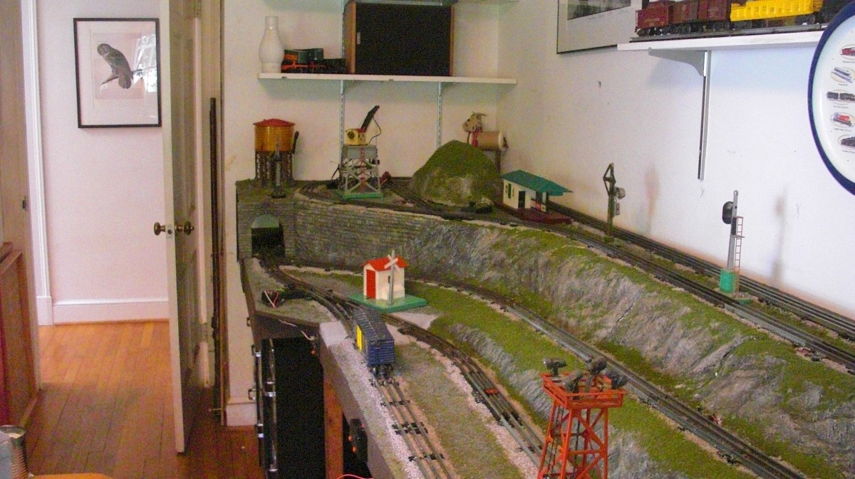 The layout has realistic ground and rock work plus a couple of wooded  hills. Most of the rock faces are removable to reach hidden track sections  and wiring.